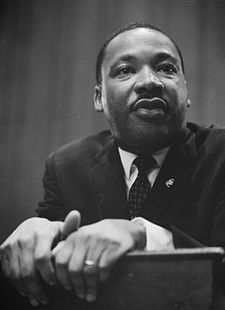 MLK leaning on a lectern; sourced from Wikipedia